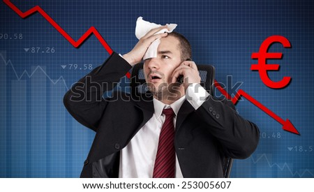 Euro crisis, currency collapse. Broker holding forehead - stock photo