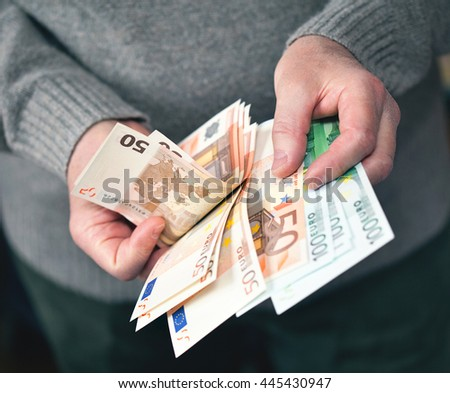 Euro currency from Europe, Euros. Hands count money - stock photo