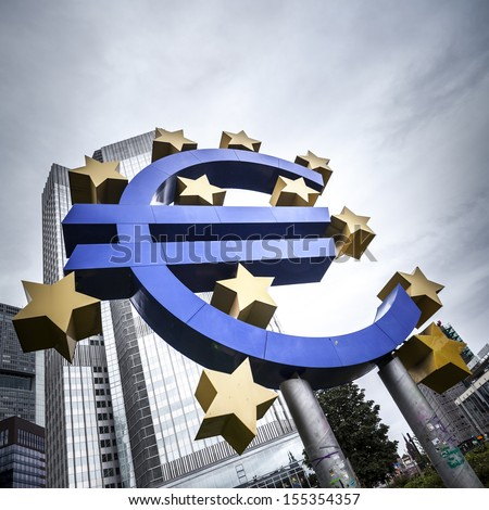 Euro currency symbol in dramatic perspective in Frankfurt - stock photo
