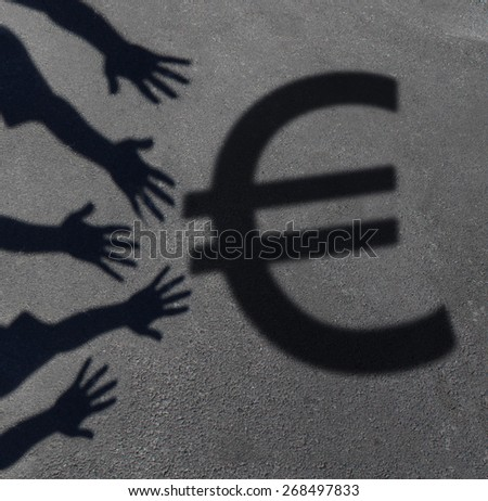 Euro demand as the cast shadow of a group of hands reaching out to grab the European currency symbol as a financial and business concept or money financing issues and economic symbol. - stock photo