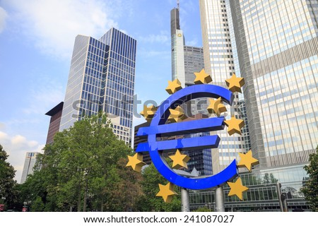 EURO DOLLAR SYMBOL AT FRANKFURT, GERMANY - APR 26: The Euro dollar symbol at the front of the European Central Bank in Frankfurt, Germany on APR 26, 2014. Euro is the official currency of the eurozone - stock photo