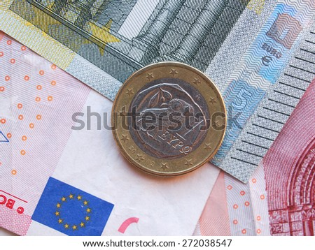 Euro (EUR) banknotes and a one euro coin from Greece - stock photo