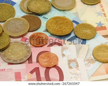 Euro (EUR) banknotes and coins money useful as a background or money concept - stock photo