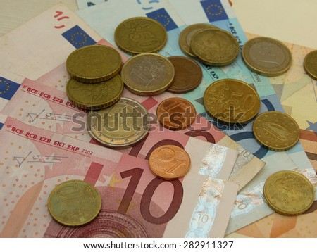Euro EUR banknotes and coins money useful as a background or money concept - stock photo