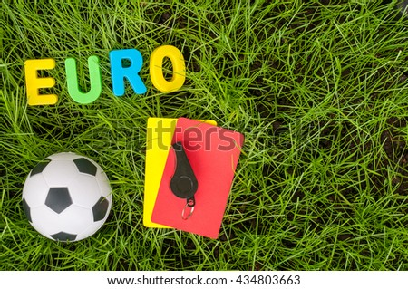 Euro football championship - image with ball, referee yellow, red card on green lawn. Symbol of soccer and fair play. Empty space for text - stock photo