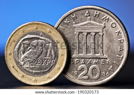 Euro from greece beside an old greek coin. - stock photo