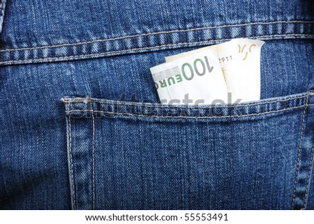 Euro in back pocket - stock photo