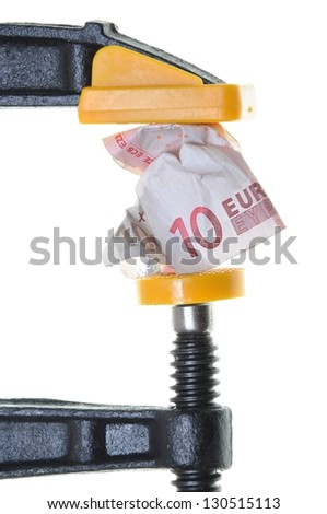 Euro in crisis, ten euro bill squeezed in a clamp isolated on white background - stock photo
