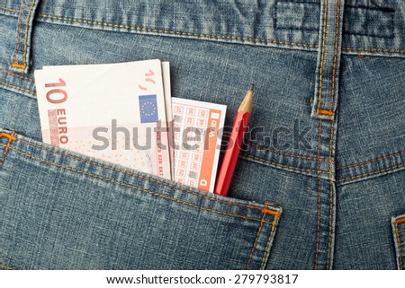 Euro money and lottery betting slip in back pocket