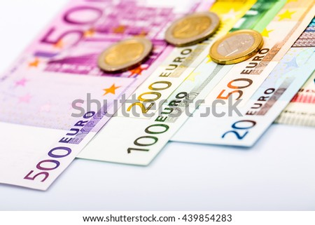 Euro money: closeup of banknotes and coins - stock photo