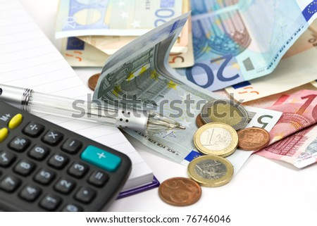 Euro money counting with calculator and pen - stock photo
