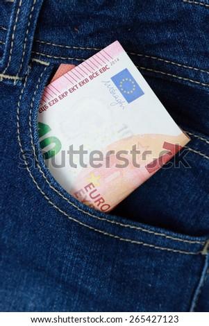 euro money in jeans pocket - stock photo