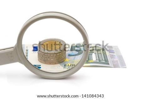 Euro money under magnifying glass - stock photo