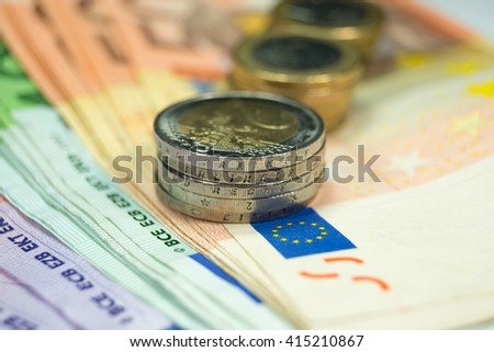 Euro notes and coins - stock photo