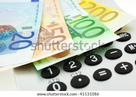 Euro notes with calculator. closeup. small GRIP - stock photo