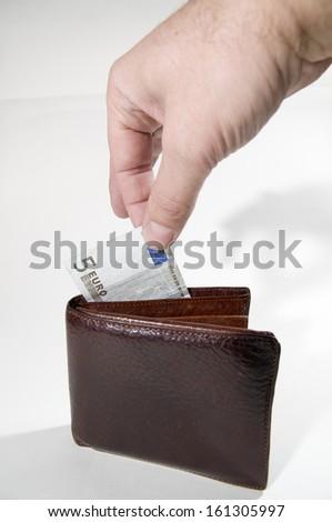 Euro purse and hand - stock photo