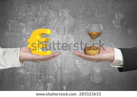 Euro symbol on one hand and hour glass on another hand, with gray concrete wall background, concept of deal and time. - stock photo