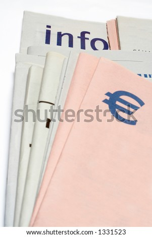 Euro symbol on Stacked newspapers a white background - stock photo