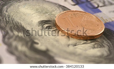 eurocent on the hundred dollar bill - stock photo