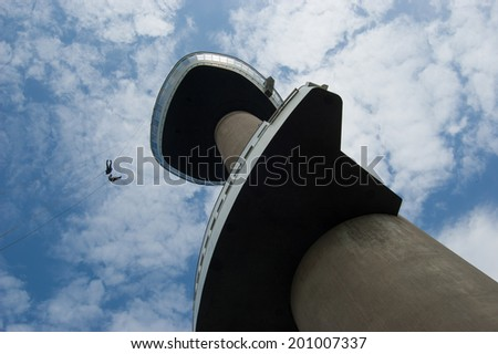 Euromast, abseiling from the tower, blue sky - stock photo