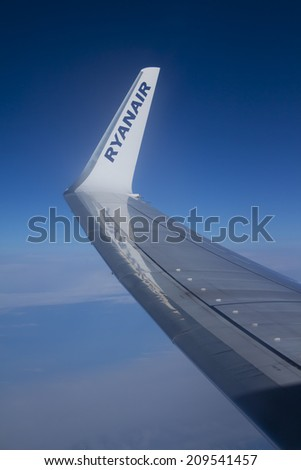 EUROPE - 28 JULY 2014: View of  the wing of a Boeing 737-800 during the Ryanair flight between Dublin and Rome on 28 July 2014. Ryanair Ltd. is an Irish low-cost airline. - stock photo