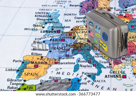 Europe map and case with stickers (my photos) - travel background - stock photo
