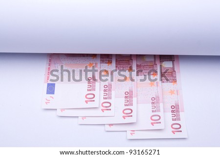 europe money euro, banknotes under roll of paper for insert text or design - stock photo