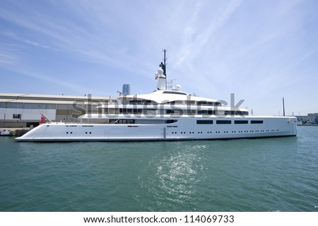 Europe,Spain, Barcelona, White yacht on an anchor in harbor - stock photo