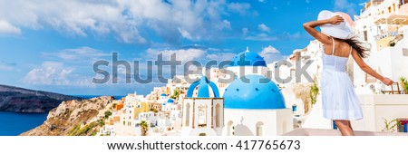 Europe tourist travel woman panorama banner from Oia, Santorini, Greece. Happy young woman looking at famous blue dome church landmark destination. Beautiful girl visiting the Greek islands. - stock photo