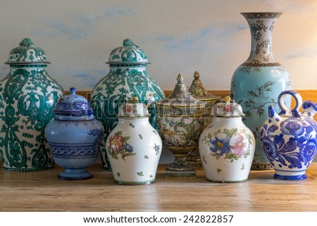 European and chinese antique vase on wooden table - stock photo