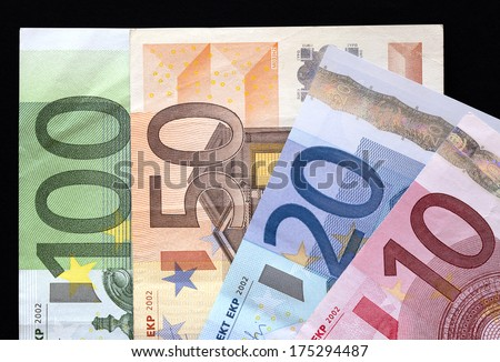 European Banknotes on black background, Euro currency from Europe, Euros. - stock photo