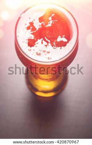 European beer concept, Europe silhouette on foam in beer glass on black table. The continents shapes are altered ones from visibleearth.nasa.gov - stock photo