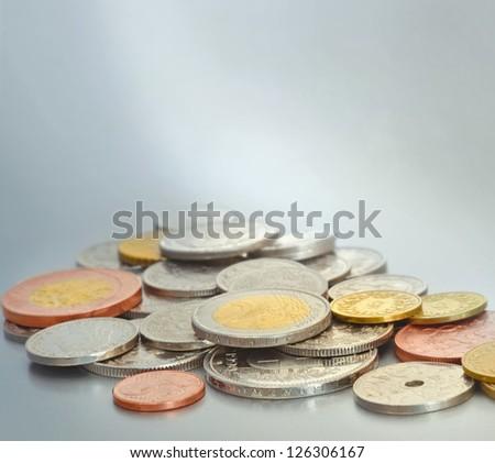 European coins swiss franc, czech krone, european euro, cent, danish crone, swedish. Sharpness on first plan. Silver background. - stock photo