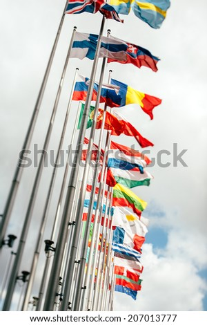 European country flags in Brussels on European commission site - European Union Parliament, tilt shift focus eurozone - stock photo