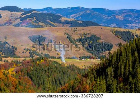 European Country Landscape of Mountains Forest and Village Autumn Season Colors - stock photo