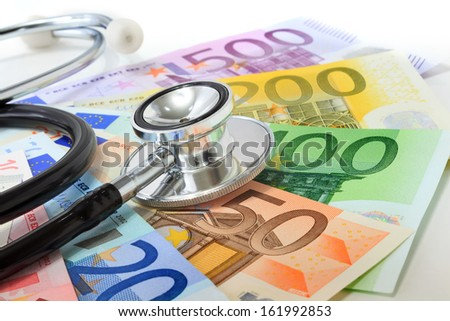 European currency sick concept: stethoscope on euro banknotes - stock photo