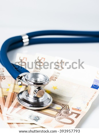 European currency sick concept: stethoscope on euro banknotes isolated on white. - stock photo
