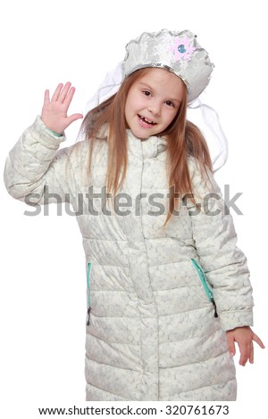 European cute young girl with a charming smile in white coats and warm in Russian headdress on a white background on Holiday - stock photo
