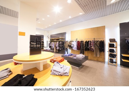 european fashionable clothing store in beautiful mall - stock photo