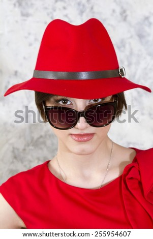 European girl in a red hat and sunglasses - stock photo