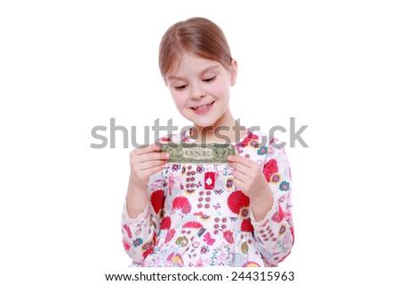 European little girl holding one dollar - stock photo