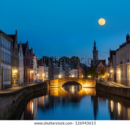 European medieval night city view background - Bruges (Brugge) canal in the evening, Belgium - stock photo