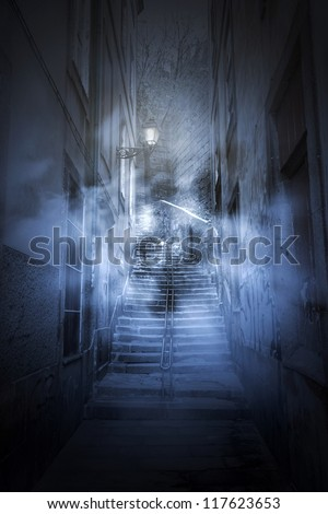 European old alley at night, in fog and scary - stock photo