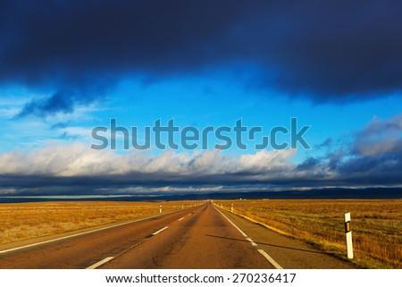 European road under  cloudy sky - stock photo