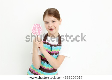 European teen girl holding sweet lollipop - stock photo