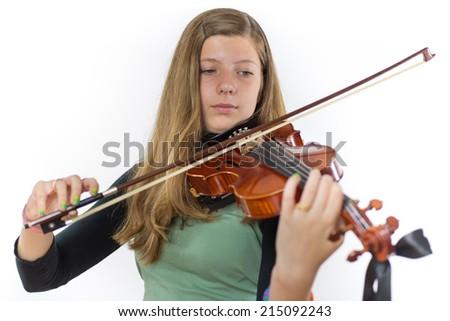 European teenage girl playing violin on white background - stock photo
