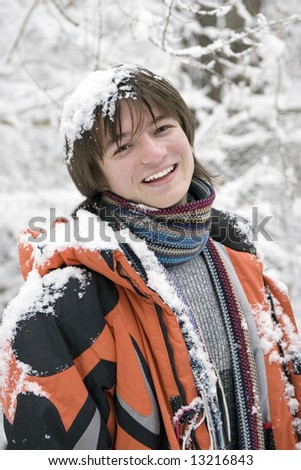 European teens boy in scarf are laughing outdoors in winter (series Sport, Extreme, Mountains, Horses and Teenagers) - stock photo