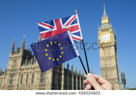 European Union and British Union Jack flag flying in front of Big Ben and the Houses of Parliament at Westminster Palace, London, in preparation for the Brexit EU referendum - stock photo