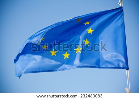 European Union blue flag with yellow stars - stock photo
