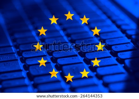 European Union flag and computer keyboard in the background - stock photo